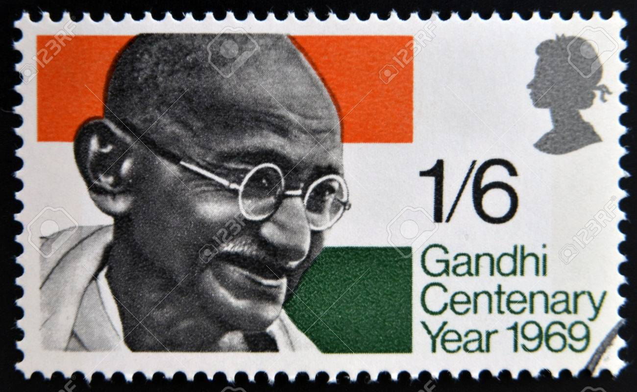 UNITED KINGDOM - CIRCA 1969: a stamp printed in Great Britain shows Mahatma Gandhi and flag of India, circa 1969